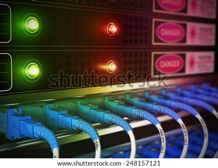 Close up of network infrastructure in data center. Blur effect with focus on patchcords at the foreground.