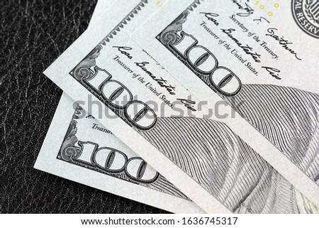 Close up of new hundred dollar bills corner.
