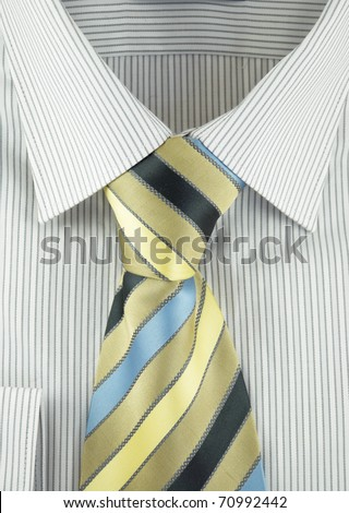 Close-up of new shirt with striped silk necktie