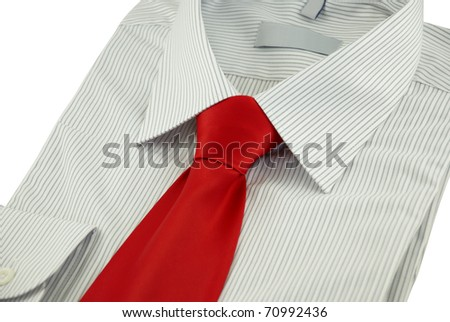 Close-up of new striped shirt with red silk necktie on a white