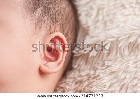 close up of newborn baby ear, showing close up of ear and side of babies head