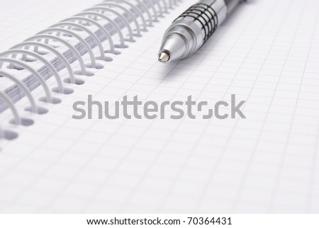 Close-up of notebook and pen