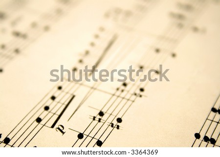 Close up of notes on an old sheet of music with shallow focus.