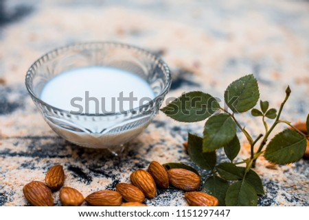 Close up of oats face pack or Avena sativa facial mask i.e  crushed or powdered almonds or badam,milk and grounded oats on wooden surface.This face pack is widely used in spa for de-tanning.