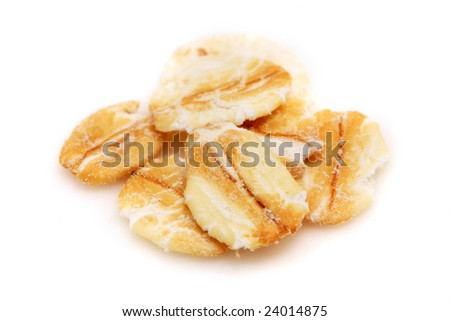 Close up of oats pieces over white background.