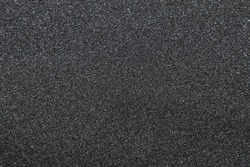 Close up of of skateboard grip tape. Macro photograph of sandpaper texture