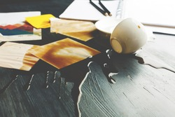 Close up of office desk with supplies and spilt coffee. Trouble and problem concept