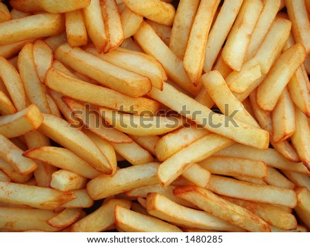 Close-up of oily French fries as a background