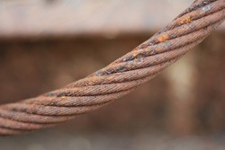 close up of old and rusty thick wire rope texture background