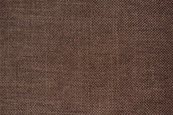 close up of old brown fabric texture. rough fabric background. old cotton (canvas) background.
