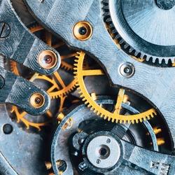 Close-Up Of Old Clock Watch Mechanism. Retro Clockwork Watch With Gearwheels Gears. Vintage Movement Mechanics.