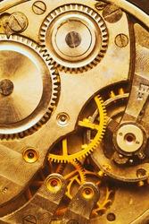 Close-Up Of Old Clock Watch Mechanism. Retro Clockwork Watch With Golden Gearwheels Gears. Vintage Movement Mechanics. Golden Colour.