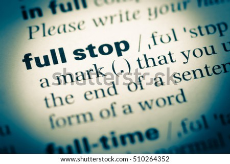 Close-up of word in English dictionary  Stop, definition and