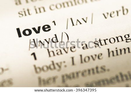 Close Up Of Old English Dictionary Page With Word Love
