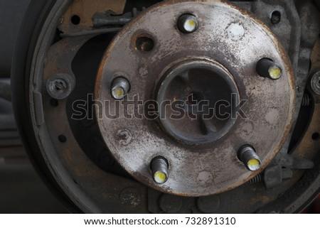 Close up of old hub wheel car. Rust on hub wheel. Rear wheel. #732891310