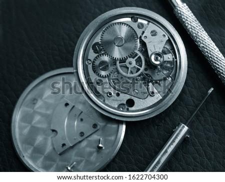 close up of  old mechanical watch mechanism under repair