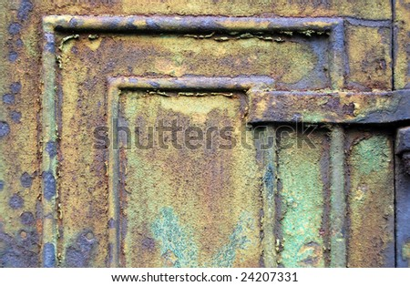 Close-up of old rusty metal cabinet door with flaking paint