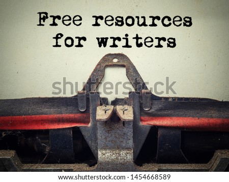 Close up of old typewriter covered with dust with free resources for writers text