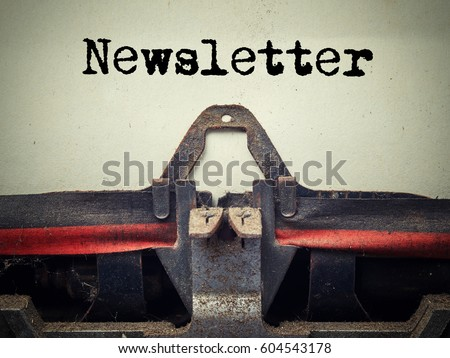 Close up of old typewriter covered with dust with newsletter text