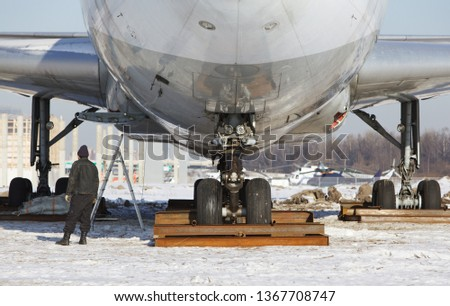 Close up of old unused large passenger plane on a snowy field, will be turned into a museum piece. Decommissioned aircraft.