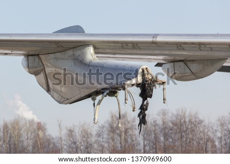 Close up of old unused passenger airplane wing without engine. Decommissioned aircraft. Detail of turbojet suspension.