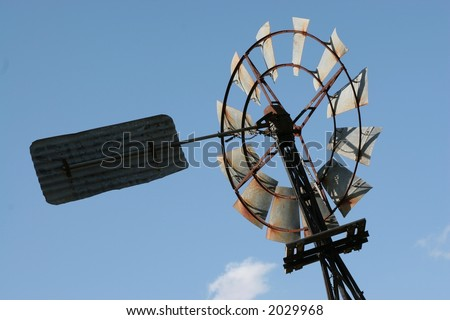close up of old water wind mill in the country