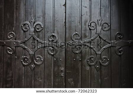 Close up of old wooden door with metal decoration