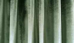 close up of olive green velvet and silky curtain.