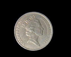 Close up of one Australian 20 cent piece, isolated on black.