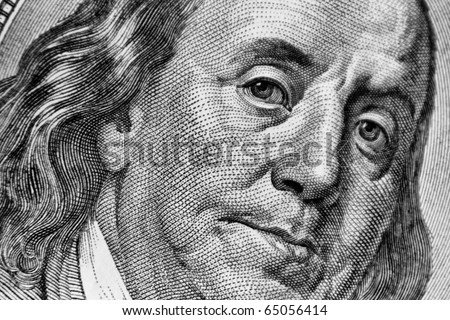 Close-up of one hundred bill Franklin portrait