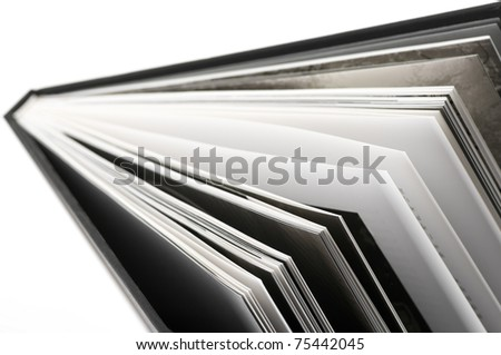 Close-up of open book. Shallow DOF.