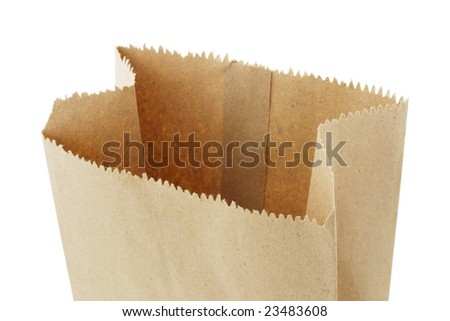 Close up of open top empty brown paper bag on white background