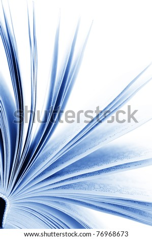 Close-up of opened book on white background. Toned image.