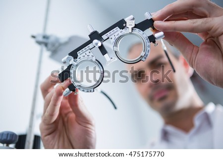 Close-up of optometrist holding messbrille in ophthalmology clinic