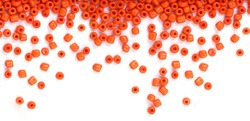Close up of Orange Beads on the white background. Background or texture of beads. macro,It is used in finishing fashion clothes. make bead necklace or string of beads for woman of fashion.