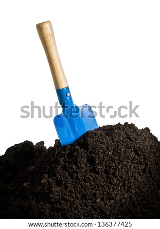 Close-up of organic soil and spade isolated on white background