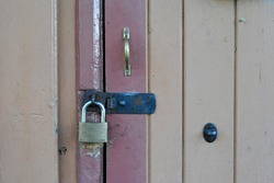 Close Up of Padlock and Hasp on Wooden Door in Close Up