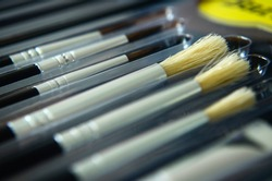 close up of pain brush set, new pain brush set, different pain brushes, color paint brush