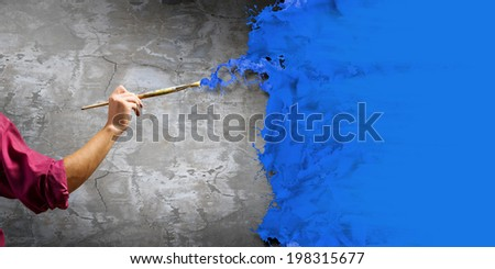 Close up of painter's hand with brush