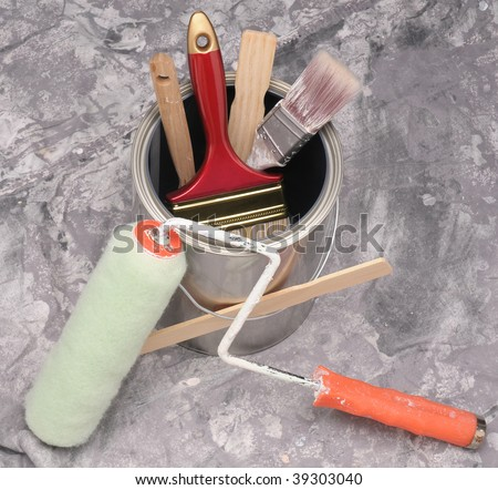 Close up of painting supplies arranged on a drop cloth - stock photo