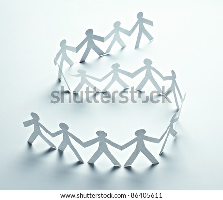 close up of  paper people on white background