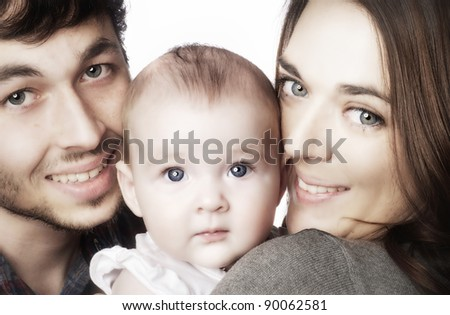 Close up of parents cuddling adorable baby.  Image isolated against white background