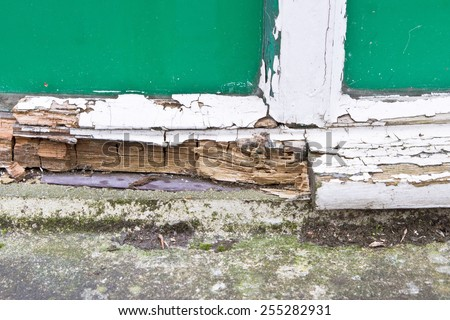 Close up of part of a wooden window frame showing extensive rot