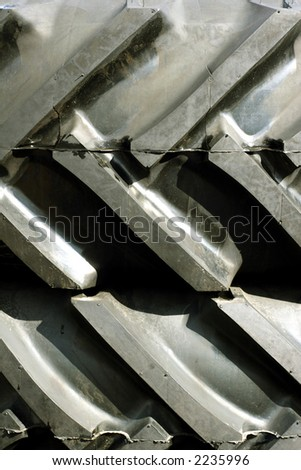close up of pattern on rubber vehicle tyre - stock photo
