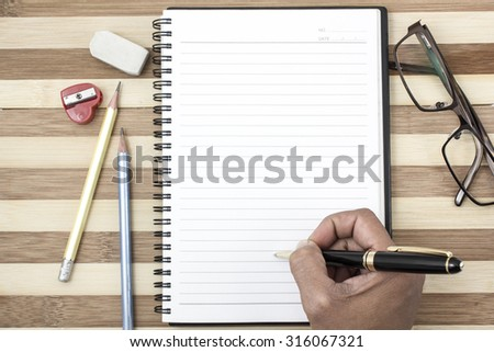 Close-up of pen on notebook business  on the wood