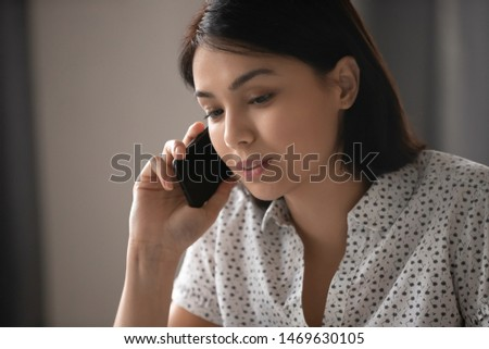 Close up of pensive young woman speak on cellphone consulting business client online, thoughtful millennial female employee talk chat on smartphone with good internet connection. Technology concept