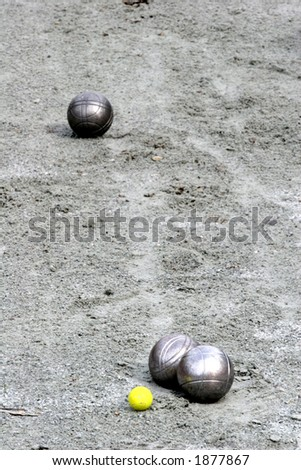 close up of people at sport,  a woman playing the french petanque