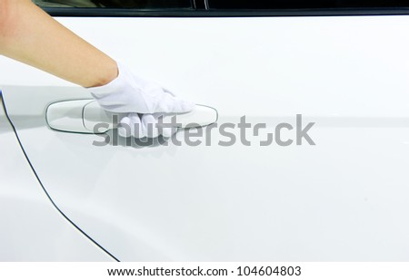 Close-up of people opening door of a white car.