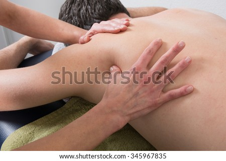 Close-up of person receiving Shiatsu Treatment from a therapist #345967835