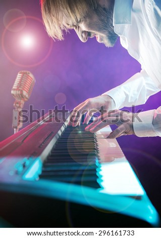 Close-up of pianist playing the piano.